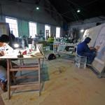 Ad Majolica - Museo Diffuso delle Maioliche della Street Art: artisti al lavoro nell'atelier della Santoriello Ceramiche d'Arte. In primo piano Sha One, più a destra Jorit. Vietri sul Mare, 2013.